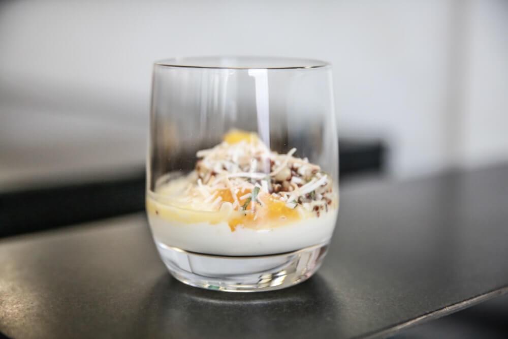 Yogurt with quinoa and coconut and orange segments 1